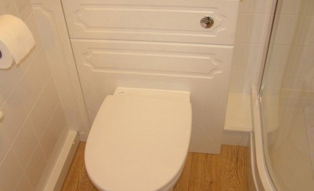 Toilet pan with concealed cistern